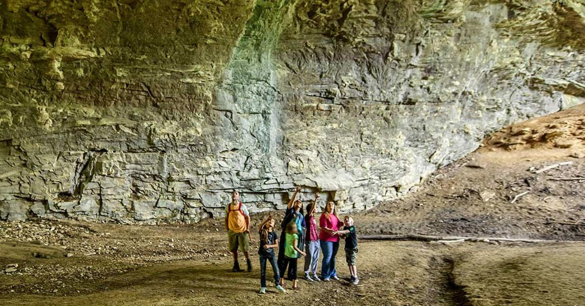 A family stands inside of Carter Caves in Eastern Kentucky