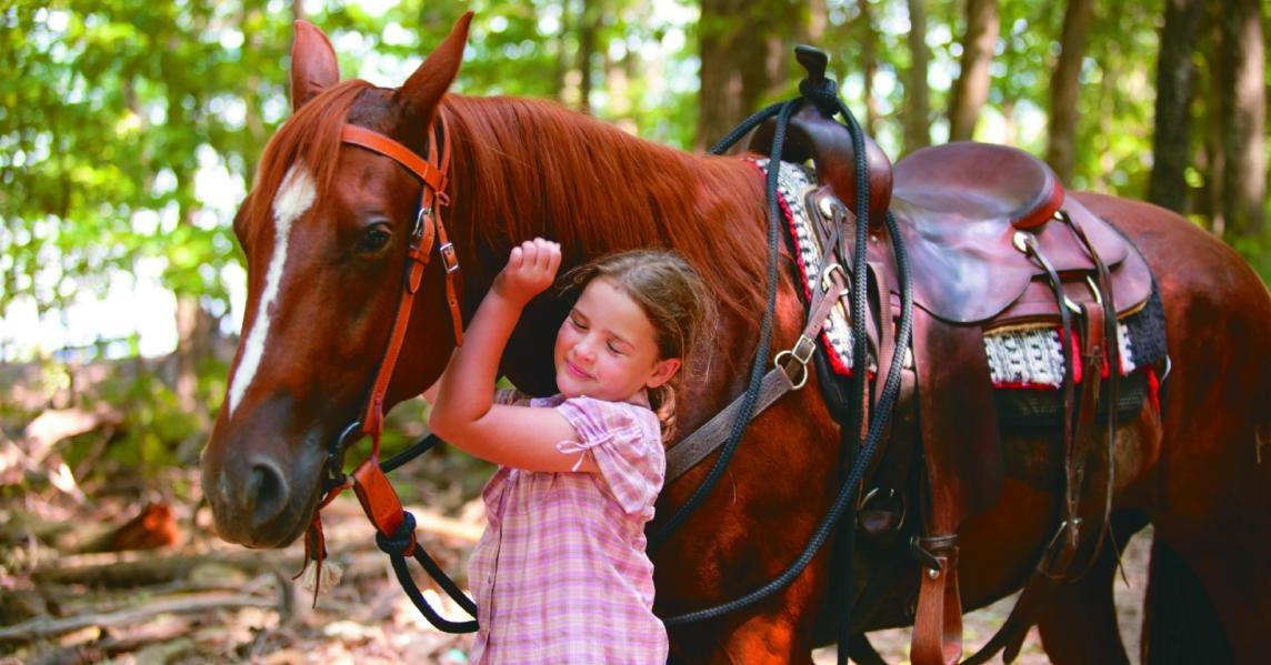 A girl hugs a horse in Kentucky