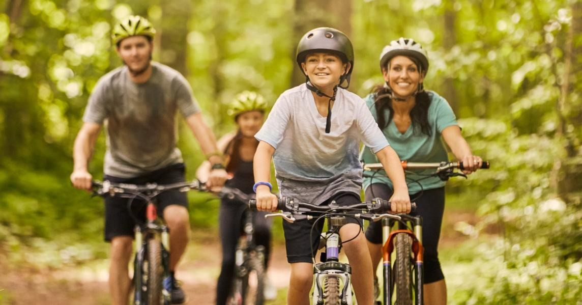 A family rides bikes at Laurel Wellness Park in London, KY