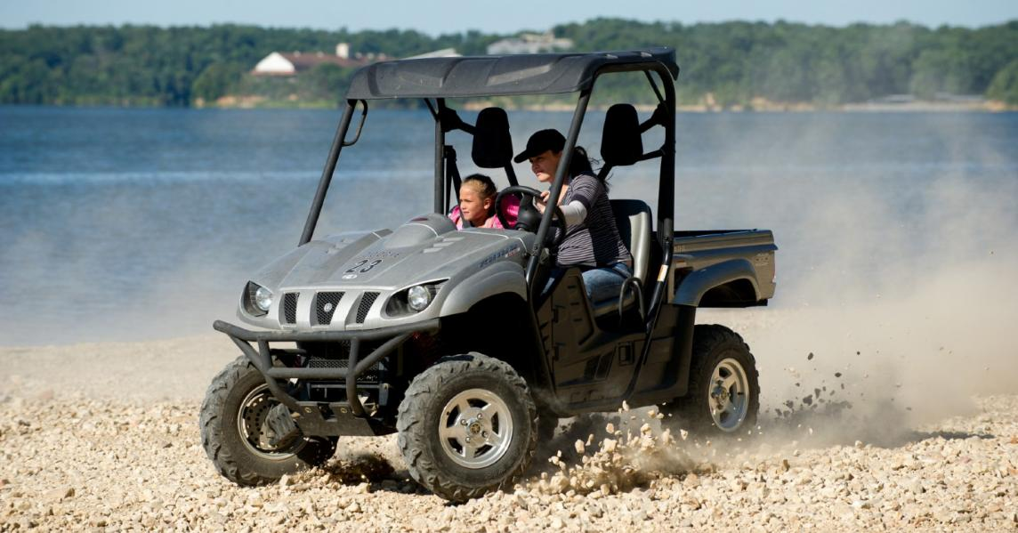 A mother and child enjoy an ATV ride in Western Kentucky