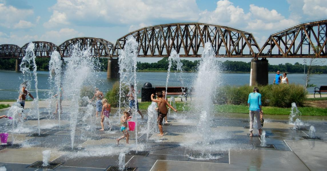 Kids splash in water fountains at Owensboro's Riverfront Park