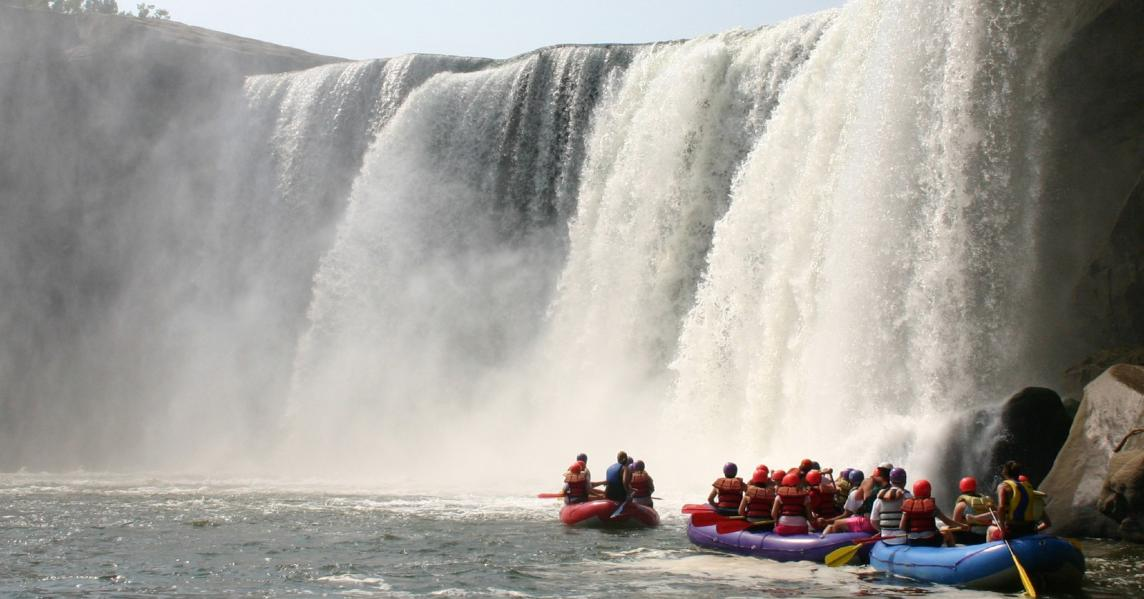 Rafters circle the base of Cumberland Falls in Kentucky