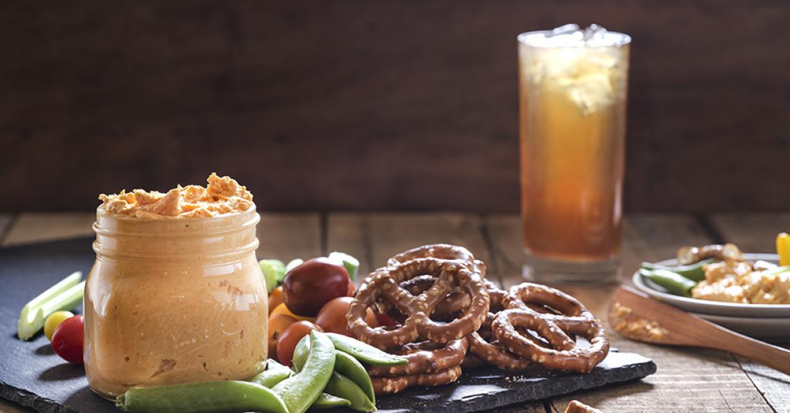 Beer cheese with pretzels and vegetables