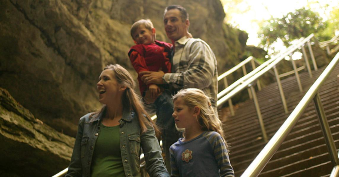 family walking down steps at mammoth cave