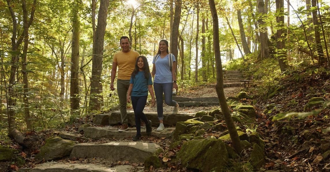 Hispanic family walking trail at Mammoth Cave