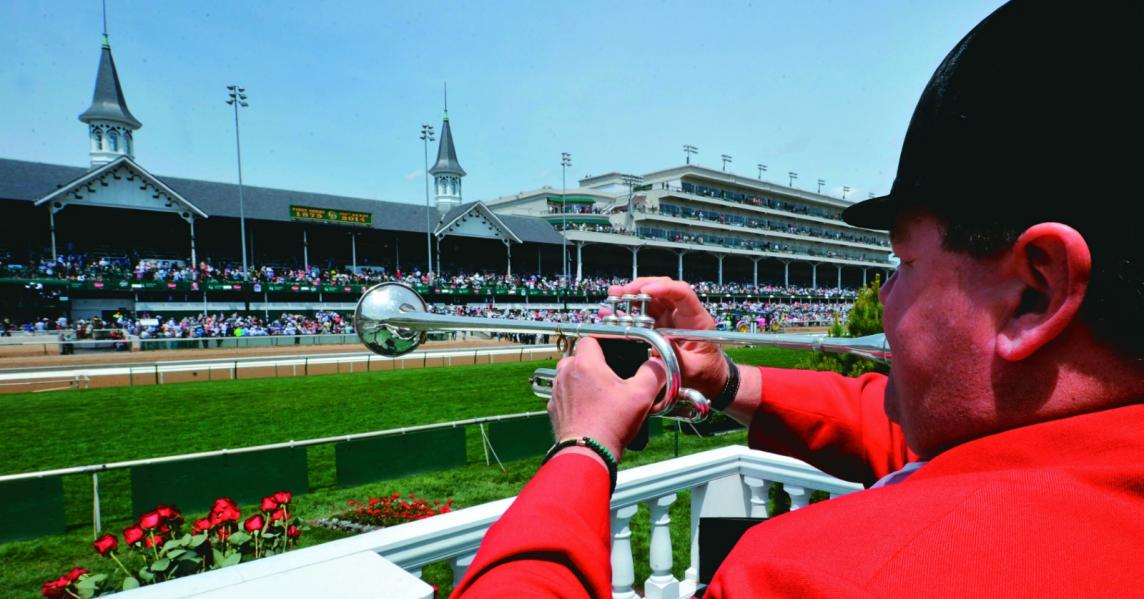 A red-jacketed bugler performs at Churchill Downs during the Kentucky Derby