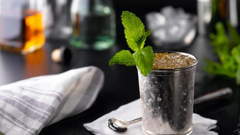 A mint julep in a traditional silver cup.