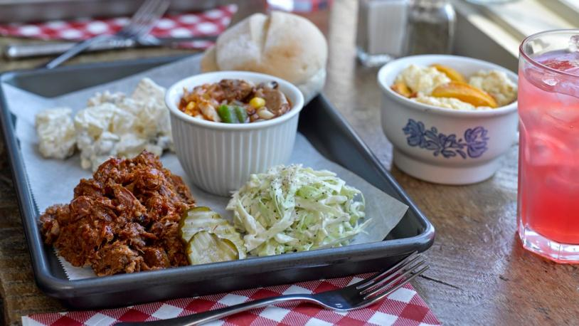 A plate of BBQ, sides and strawberry lemonade from Kentucky's Bluegrass, Blues & BBQ region