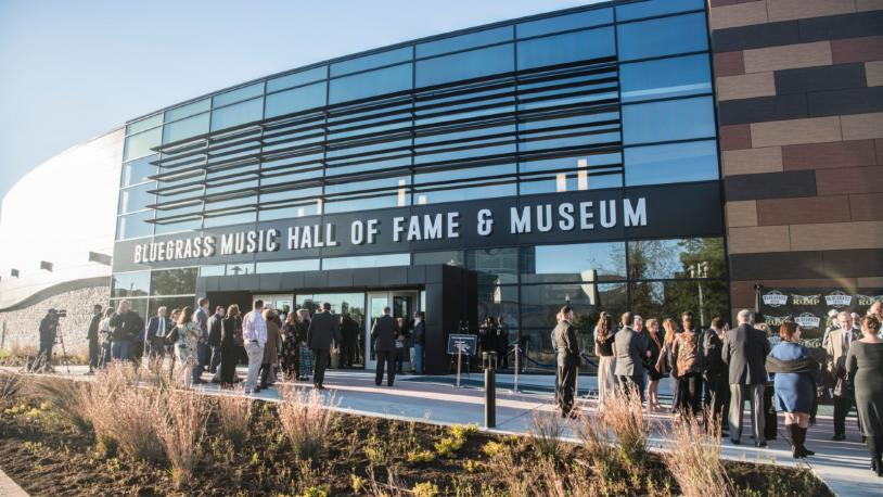 An exterior shot of the glassy Bluegrass Music Hall of Fame & Museum in Owensboro