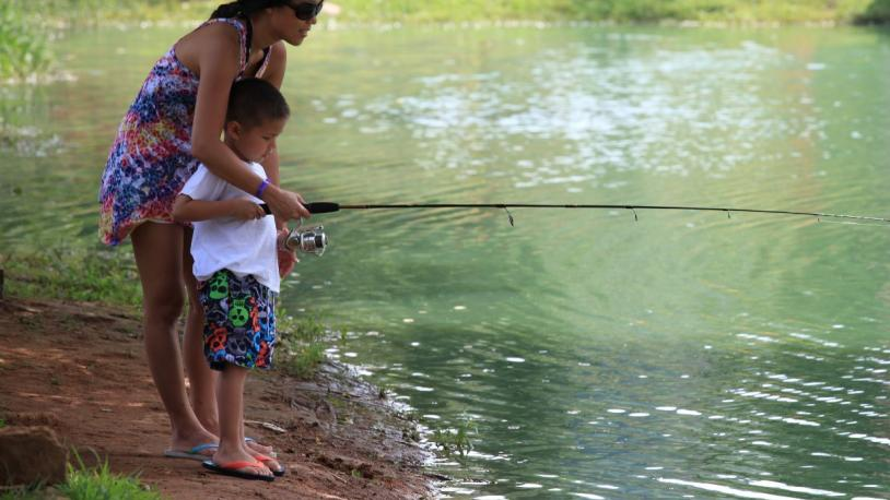 mom and son fishing at a lake