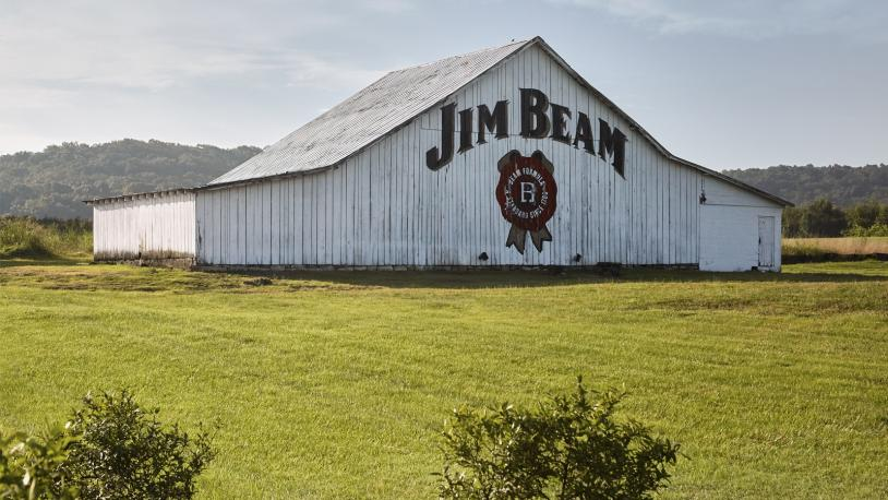 Exterior of Jim Beam barn with white paint with Jim Beam logo