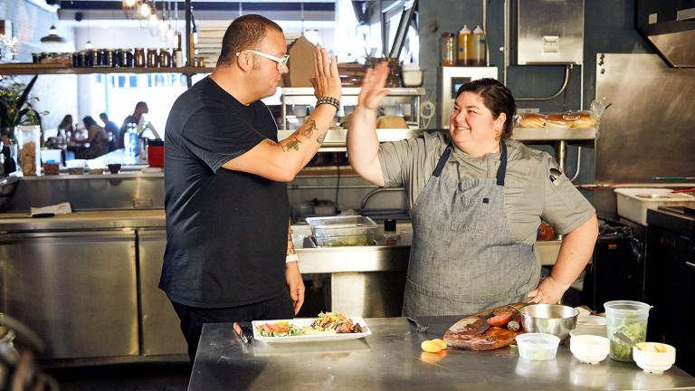 Host Graham Elliott watches a Kentucky chef in action
