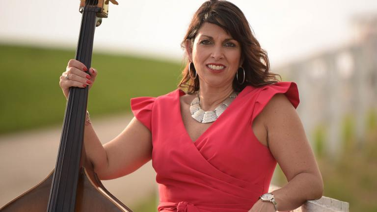 Kentucky musician Billie Renee Johnson poses with her bass guitar