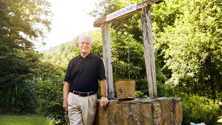 Bob Scott, a Hatfield descendant from Eastern Kentucky, stands by a historic well
