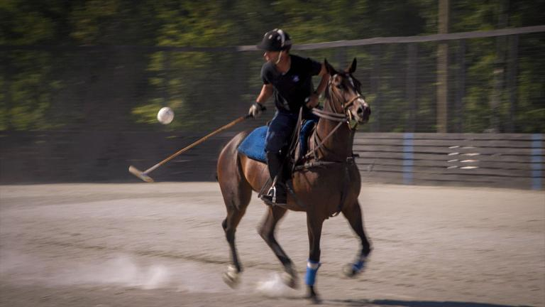 A man plays polo at the Commonwealth Polo Club in Kentucky