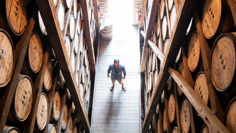 Host Adam Glick stands inside the warehouse at Woodford Reserve bourbon distillery