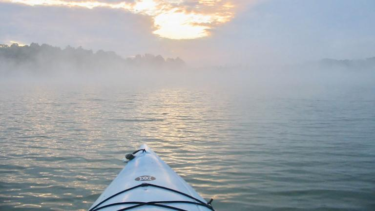 Sunrise with kayak on the water