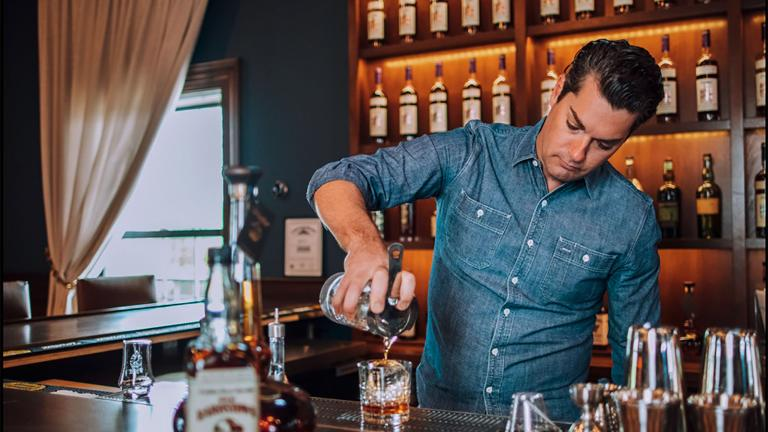 Bartender pouring bourbon at Willett Distillery